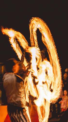 fire man performing fire dance flame