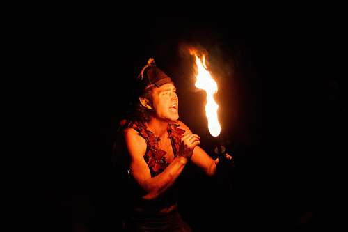 person man with torch fire