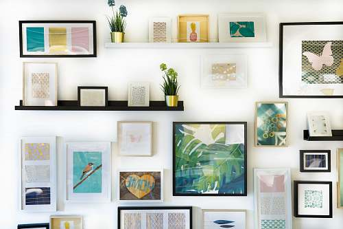 home assorted-color framed paintings on the wall art