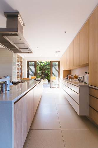 home white wooden kitchen island and cupboard cabinets near glass panel door kitchen
