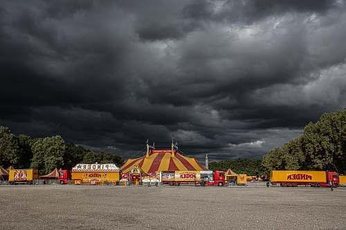 weather circus underneath cumulus clouds urban