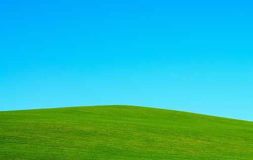 outdoors green hill under blue sky green