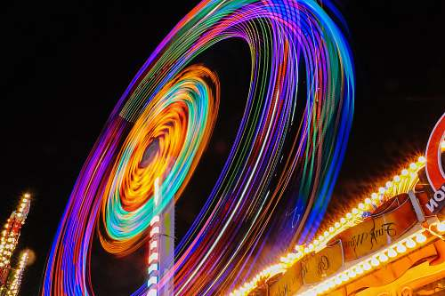circle time lapse photography of Ferris wheel spin
