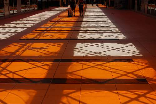 cloud two person walking inside building with orange floor design
