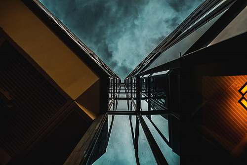 canada low angle photography of high-rise building under blue clouds architecture