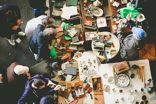 table photo of people doing artworks jumble