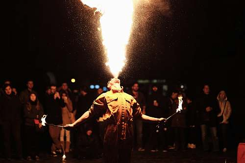 people person breathing fire performer