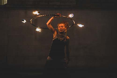 human woman performing fire dancing juggling