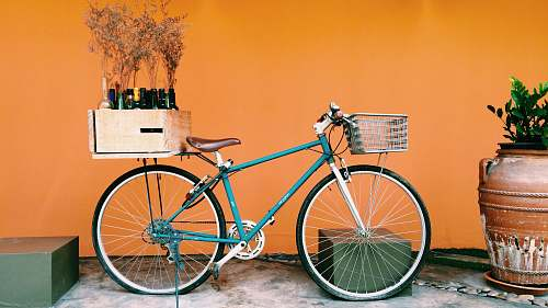 photo bike blue and black city bike on white flooring bicycle free for commercial use images