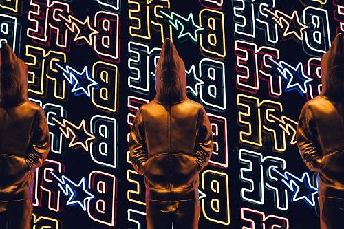 poster person standing in front of LED light neon