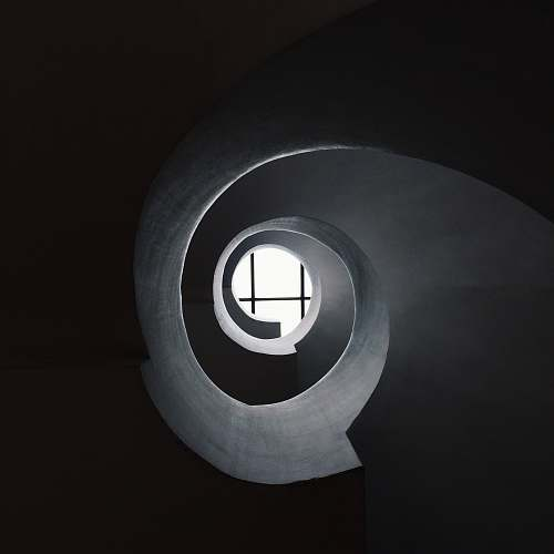 window bottom view of concrete spiral stair abstract