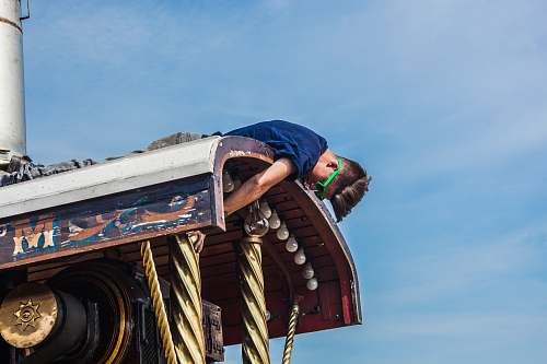 faiground man on top of metal roof at daytime traction engine