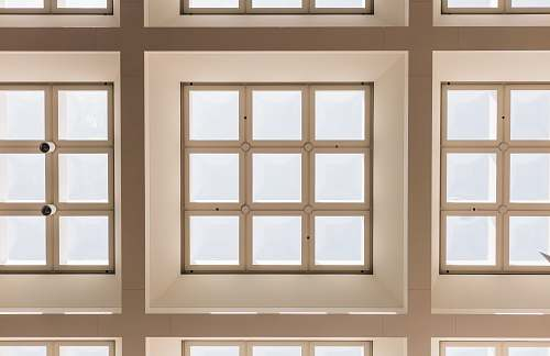 ceiling closeup photo of white and brown paneled frame lot skylight