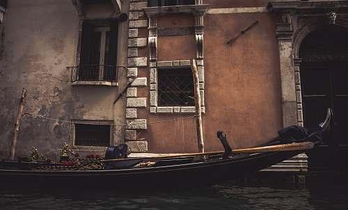 venice boat near concrete structure gondola