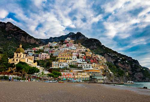 photo house multicolored village on mountain under white and blue skies building free for commercial use images