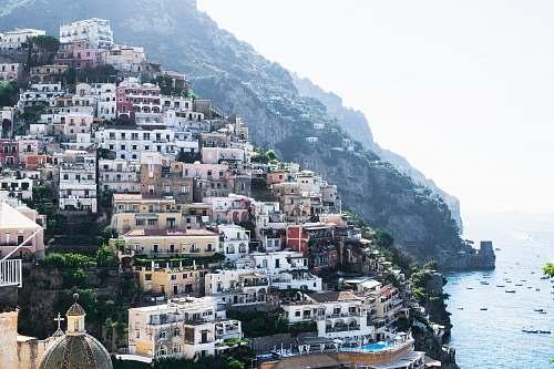 town photo of houses near ocean during daytime positano