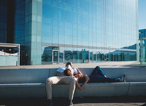 photo man and woman laying on concrete stairs free for commercial use images