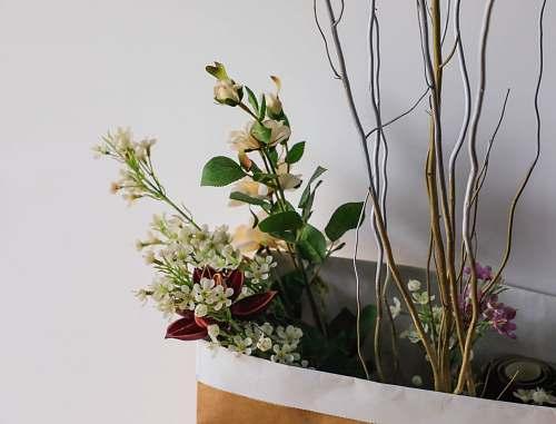 vase assorted flowers in shopping bag flower arrangement