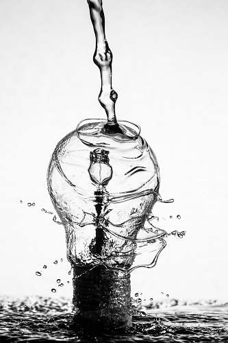 black-and-white water dropping on light bulb water