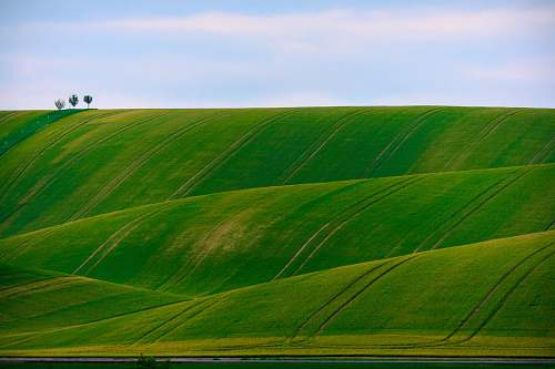 landscape panorama photography of green hills rolling hill