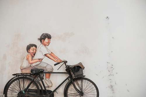 bike two children riding bicycle painting bicycle