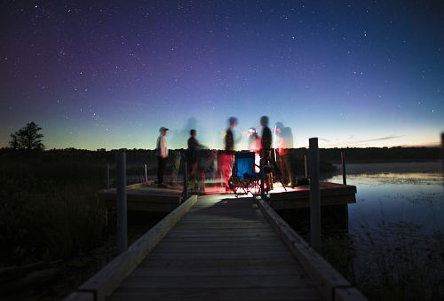 photo person illustration on brown wooden dock stage photography during nightime free for commercial use images