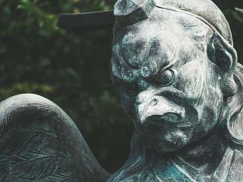statue gray concrete eagle statue during daytime sculpture