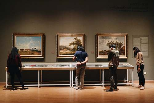 person people standing in front of paintings human