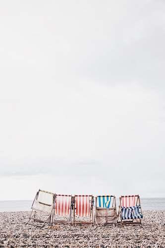 beach five chairs near costline chair