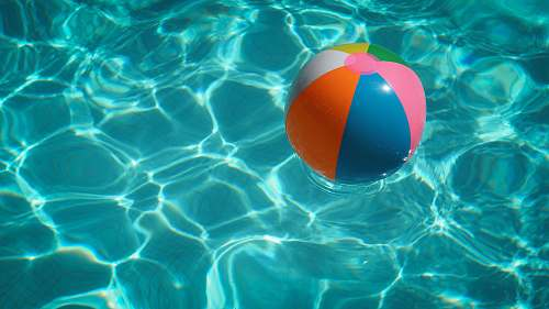 water white and multicolored beach ball pool