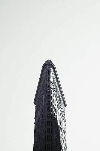 building grayscale photography of flat-iron building new york