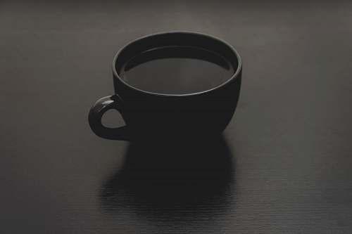 black black ceramic mug with liquid close up photo cup