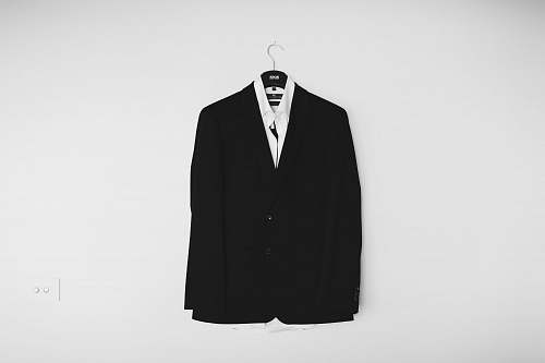 black black suit jacket hanged on wall suit