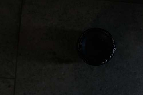 photo black closeup photography of camera lens on floor tile lens free for commercial use images