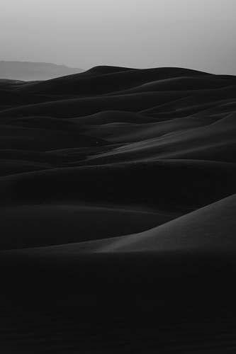 black grayscale photo of desert grey
