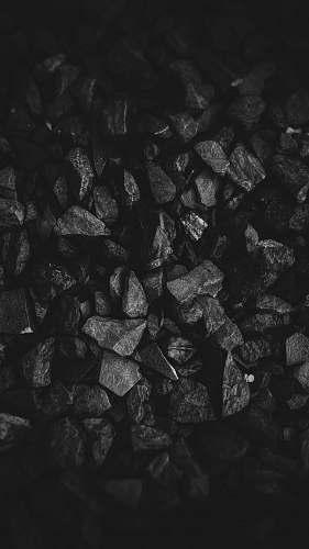 black grayscale photo of stone grey
