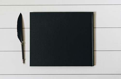 pen black book with pen transportation
