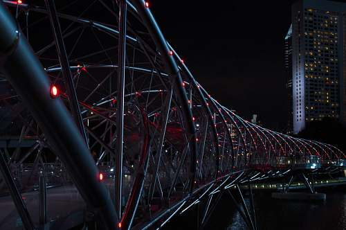 architecture gray Helix Bridge with red lights at nighttime singapore