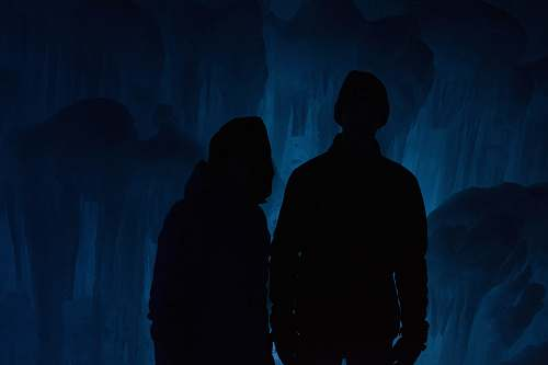 human silhouette of man and woman inside cave person