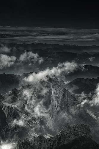 alps grayscale photo of mountain range mountain
