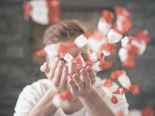 human man scattering flower petals people