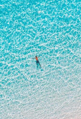 sea bird's eye view of man on body water nature
