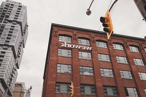 city Wework building beside traffic light during daytime urban