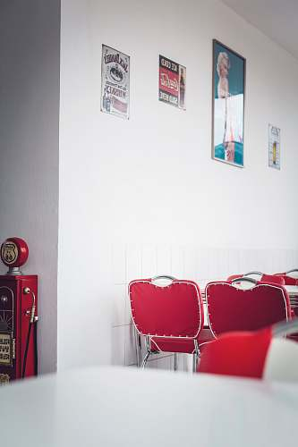 furniture empty chairs beside wall with posters and signs interior design