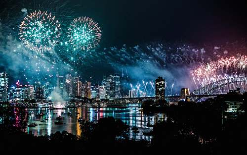outdoors bird's-eye view photography of fireworks above city nature
