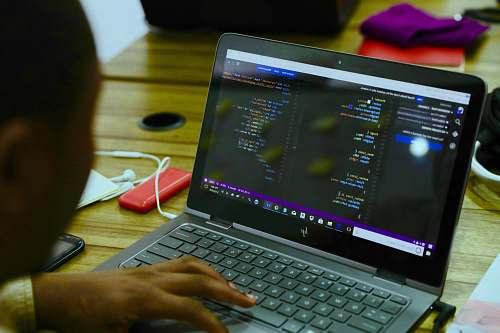 computer black HP laptop displaying C++ language lagos