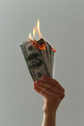dollar time lapse photography of several burning US dollar banknotes fire