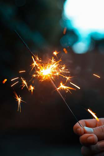 outdoors person holding sparkler night