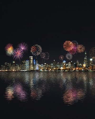 outdoors skyline buildings under fireworks display night