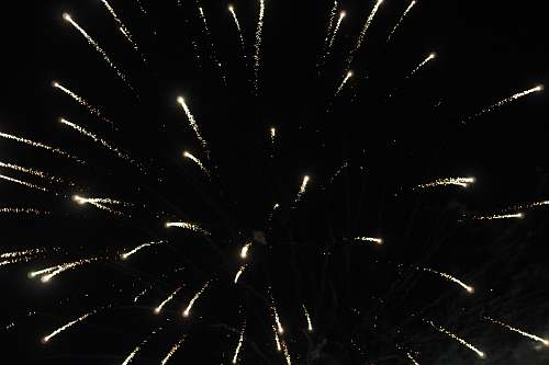 outdoors yellow fireworks during nighttime nature